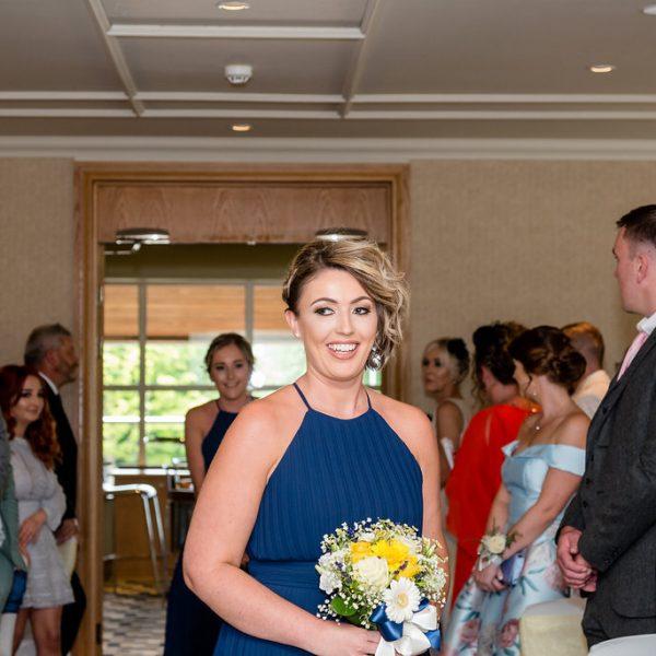 Bridesmaid walking the aisle