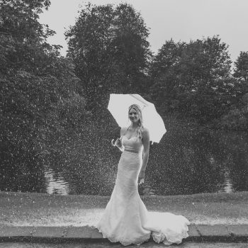 Bride in the rain at East Riddlesden Hall