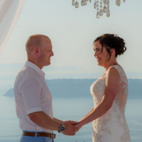 Exchanging vows at Santorini wedding