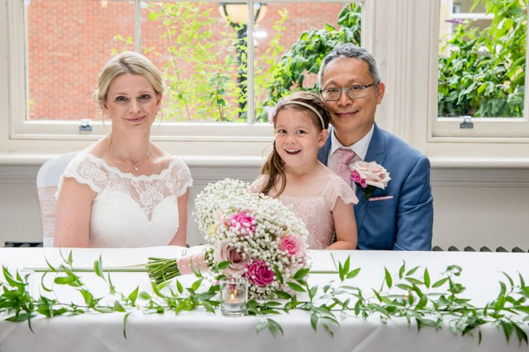 Bride, Groom and their daughter Groomsmen at Oulton Hall Wakefield