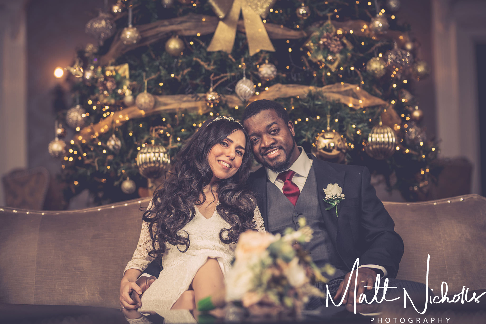 A wedding photograph in the great Hall at Oulton Hall Leeds