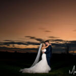 Bride and Groom at sunset Priory Cottages Wedding